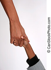 A father holds his son\'s hand