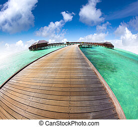 beautiful maldives  beach and water villa with fish-eye lens