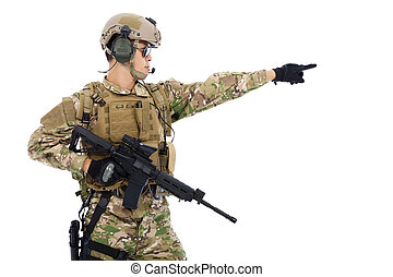 Soldier holding rifle or sniper and directing
