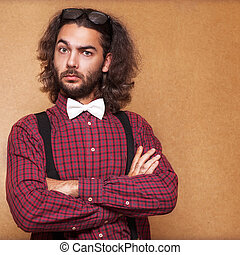 Portrait of handsome long-haired stylish man Hipster style
