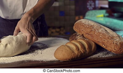 Kneading Dough - Truck left of unidentified male chef...