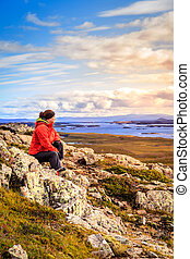 Helgafell Mountain - A woman admiring the view from the top...
