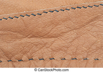 leather - brown leather background and stitches