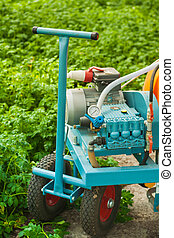 Agricultural equipment in greenhouse closeup