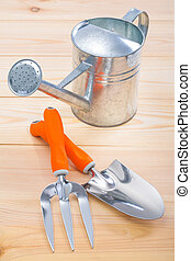 tools trowel fork and watering can