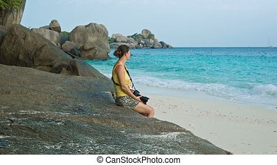 Tourist sitting on the beach Similan Islands, Thailand -...