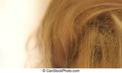 Hair comb. Hairstyle - Hands do hair on his head. Close up.