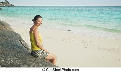 Woman sitting on the beach Similan Islands, Thailand - Video...