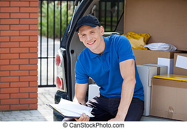 Delivery man taking break from work - Portrait of a smiling...