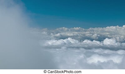 Cumulus clouds in the sky - a view from a high mountain....