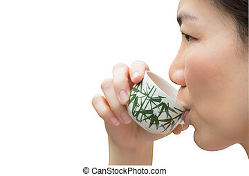 Asian woman drinking tea on white background with paths