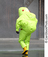 man with the jumpsuit for the biohazard during a chemical...