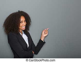 Friendly business woman pointing finger - Close up portrait...
