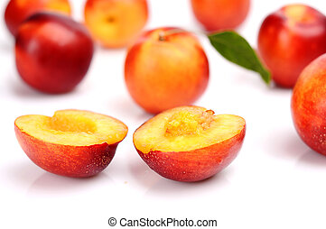 Several sliced nectarines isolated on white - Many sliced...