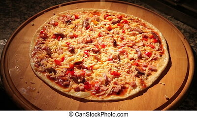 Pizza sprinkled with grated cheese.