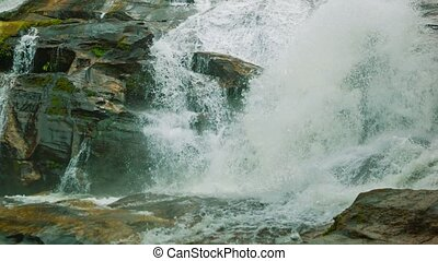Water flowing over rocks Waterfall on a small river near...