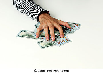Closeup of a male hand hold dollars on the table