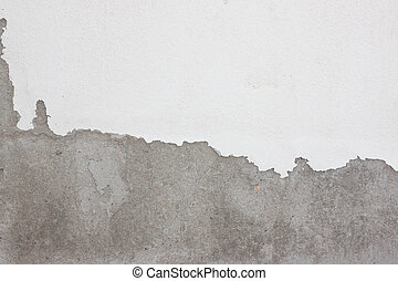 Grungy cracked white wall paint peeling off