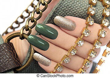 Green manicure. - Green manicure with a brilliant gold...