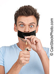 Adult man trying to quit smoking on white background. front...