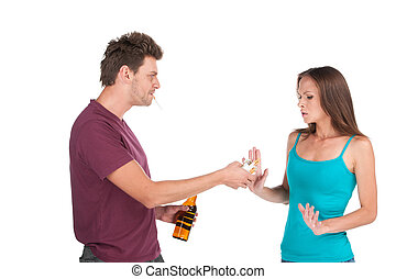 Drunk man gives alcohol to girl man and woman standing over...