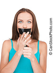 young woman trying to quit smoking. Beautiful young woman with sticky tape on her mouth