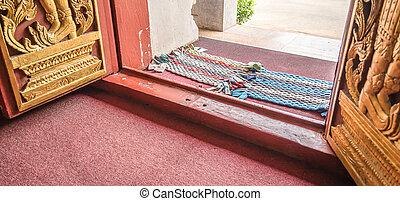 handmade foot scraper on the floor - foot scraper on the...