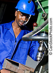 factory worker - man drilling in factory