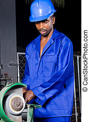 factory worker - man using equipment in factory