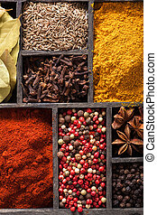 spices in box pink black pepper paprika powder curry bay...
