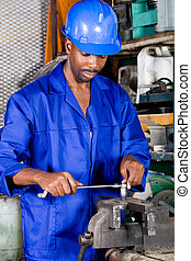 factory industrial worker - man using tools in factory