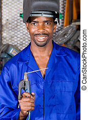 african welder - african man with welding gear