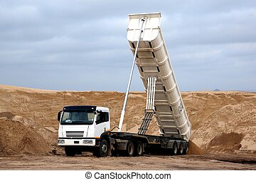 Tipper Truck in Sand Quarry - Huge tipper truck with...