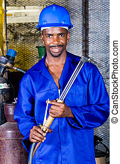factory worker - happy african man in factory