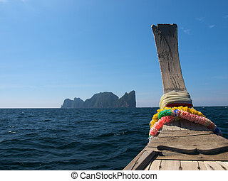 Boat trip - Bow of a traditional thai longtail boat in sea
