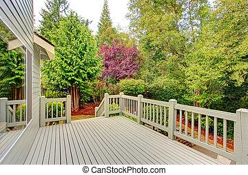 Walkout deck overlooking green belt - Wooden walkout deck...