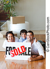 Family on the floor after buying house with copy-space