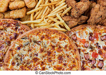 fastfood chicken nuggets, legs, pizzas and fry potatos -...