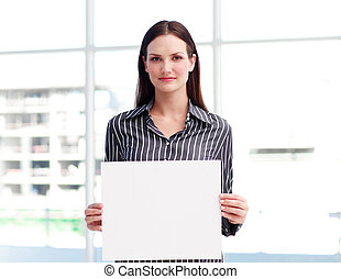 Portrait of a businesswoman holding a card