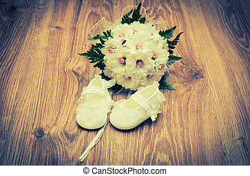 Shoes and bouquet on a wooden floor - White shoes and white...