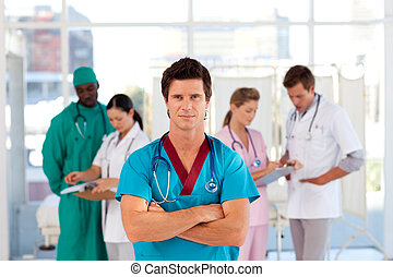 Cofident doctor with his team in the background