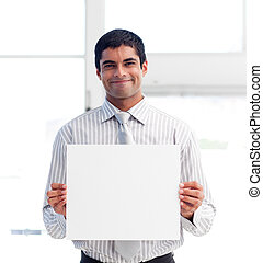 Portrait of a businessman holding a white card