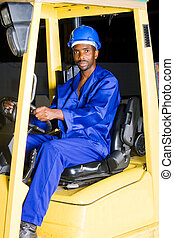 man operating forklift - man steering a forklift