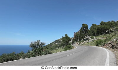 Coast Highway - Asphalt road along a sea coastline on...