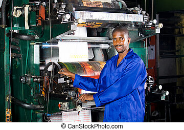 factory employee - man working in factory with printing...