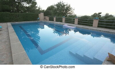 Swimming pool with reflection on the water