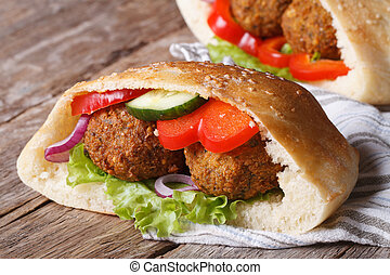 falafel with vegetables in pita bread closeup horizontal -...