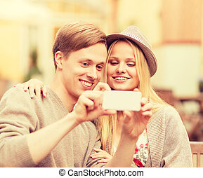 couple taking selfie with smartphone - summer holidays,...