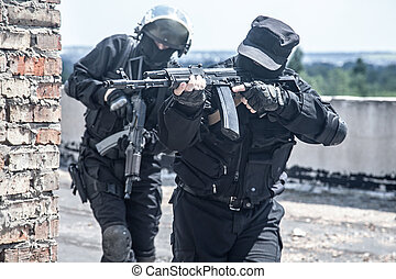 spec ops soldiers - Two spec ops soldiers in black uniform...