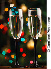 pair of champagne glasses on the threshold of new year